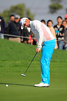 Mikko Ilonen (FIN) takes his putt on the 16th green during Sunday's Final Round of the 2014 BMW Masters held at Lake Malaren, Shanghai, China. 2nd November 2014.<br /> Picture: Eoin Clarke www.golffile.ie