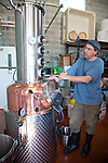 Stone Barn Brandyworks, a micro-distillery in SE Portland, Oregon run by Sebastian and Erica Degens.  They make products that include rye whiskey, pear brandy, and other varieties of distilled spirits and operate out of a very small, green warehouse space.  Their products are not yet for sale other than directly from them.  Sebastian Degens giving a tour of the small distillery in their warehouse space.