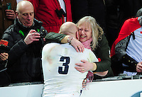 Dan Cole of England celebrates with his family after the match. RBS Six Nations match between France and England on March 19, 2016 at the Stade de France in Paris, France. Photo by: Patrick Khachfe / Onside Images