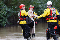 Pictured: An elderly residents being evacuated by the fire service in Nantgarw, Wales, UK. Sunday 16 February 2020<br /> Re: Residents from Oxford Street in the village of Nantgarw had to be evacuated in inflatable boats by the Fire Service after rover Taff burst its banks in south Wales, UK.