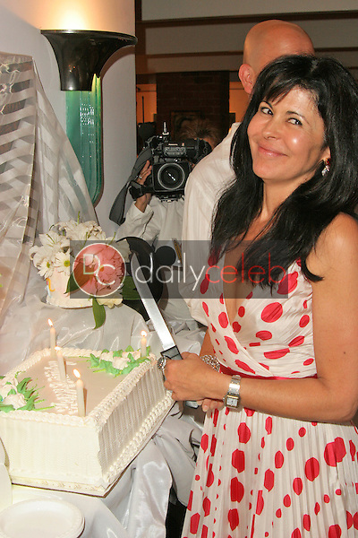 Maria Conchita Alonso cuts her birthday cake<br />