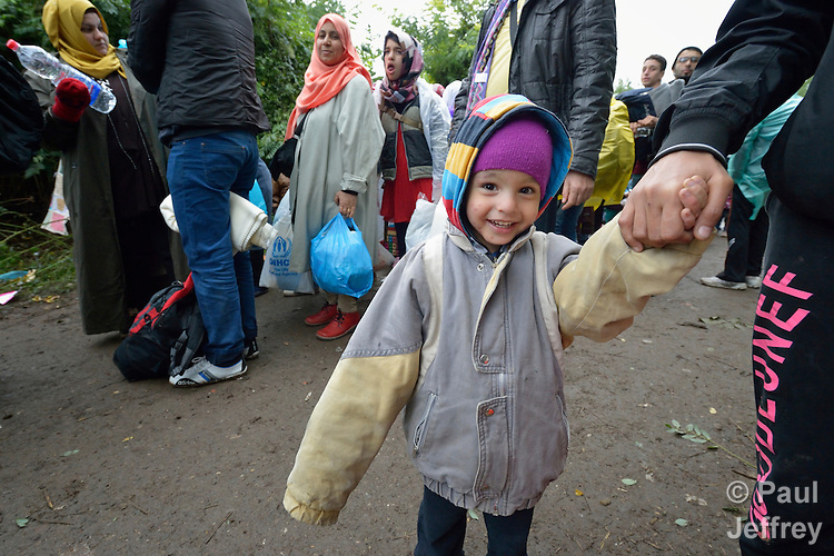 Holding a parent's hand, a refugee child approaches the border into Croatia near the Serbian village of Berkasovo. Hundreds of thousands of refugees and migrants from Syria, Iraq and other countries--including many children--have flowed through Serbia in 2015, on their way to western Europe.