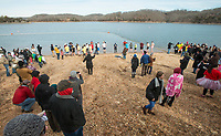 NWA Democrat-Gazette/BEN GOFF @NWABENGOFF<br /> Participants take the plunge Saturday, Feb. 9, 2019, during the Special Olympics Arkansas Beaver Lake Polar Plunge at Prairie Creek recreation area. Divers measured the water temperature at 44 degrees Fahrenheit and the air temperature in nearby Rogers rose to 30 degrees Fahrenheit by the time participants dove in, according to the National Weather Service. The annual event is a fundraiser for Special Olympics Arkansas.