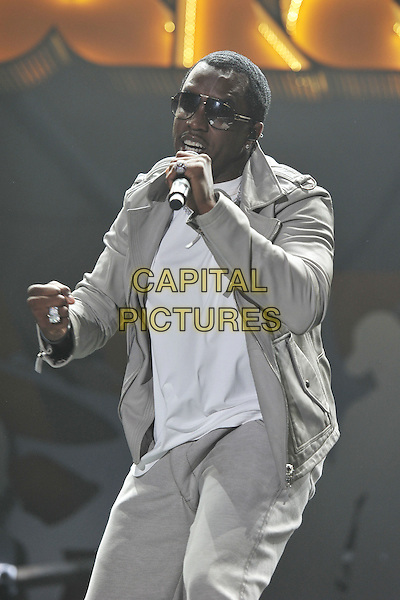 Dirty Diddy Money.Orange Rockcorp Concert, Wembley Arena, London, England..puff daddy sean combs stage concert live gig performance music half length white to grey gray jacket singing sunglasses shades.CAP/MAR.© Martin Harris/Capital Pictures.