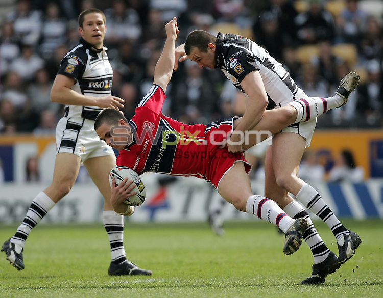 PICTURE BY Ben Duffy-Engage Rugby Super League, Hull FC v Hull KR- 09/04/07..Copryright-SWpix 01943608782..Hull FC's Paul Cooke dumps Hull KR's Scott Murrell