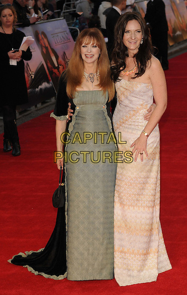 Frances Fisher & Rochelle Rose.'Titanic 3D' world premiere, Royal Albert Hall, London, England..27th March 2012.full length black green dress long coat jacket pink beige print strapless  .CAP/CAN.©Can Nguyen/Capital Pictures.