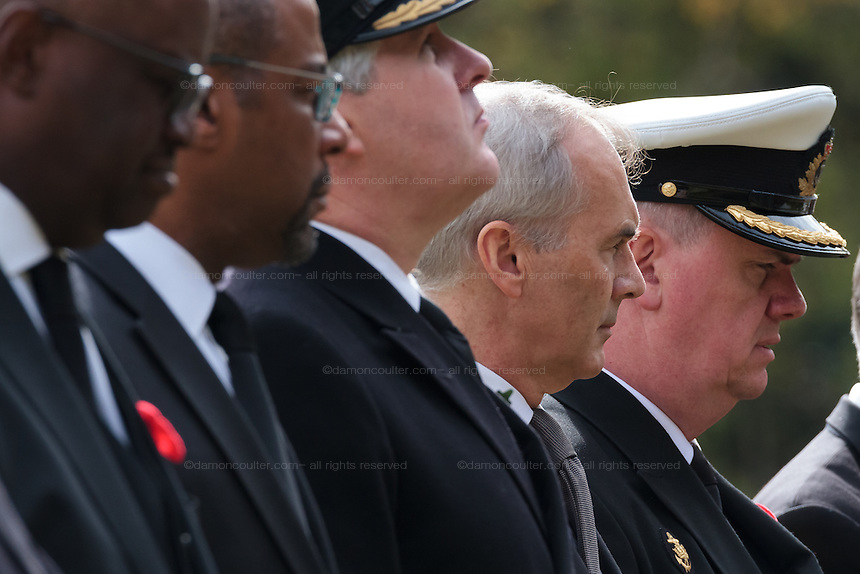 The British Ambassador in Tokyo, Tim Hitchens stands between military personnel and other government representatives during the Remembrance Day ceremonies at the Commonwealth War Cemetery in Hodogaya, Yokohama, Japan. Wednesday November 11th 2015