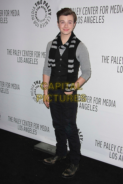 "CHRIS COLFER.The PaleyFest 2011 Panel for ""Glee"" held at The Saban Theater in Beverly Hills, California, USA..March 16th, 2011.full length waistcoat grey gray black scarf jeans denim hand in pocket.CAP/ADM/TB.©Tommaso Boddi/AdMedia/Capital Pictures."