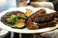 Grilled sausages with vegetables on plate
