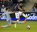 Graham Zusi (L) of Sporting KC tries to block the shot on goal by Jesus Gallardo  of C.F Monterrey during their CONCACAF Champions League semifinal soccer game on April 11, 2019 at Children's Mercy Park in Kansas City, Kansas.  Photo by TIM VIZER/AFP