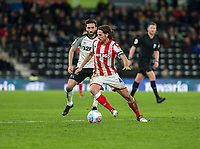 31st January 2020; Pride Park, Derby, East Midlands; English Championship Football, Derby County versus Stoke City; Joe Allen of Stoke City turns suddenly with the ball at his feet marked by Graeme Shinnie of Derby County