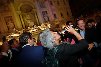Anna Paola Concia beve dello spumante <br /> Roma 11-05-2016. Fontana di Trevi. Festeggiamenti per l'approvazione del DDL sulle Unioni Civili. Per l'occasione la Fontana di Trevi e' stata illuminata con i colori arcobaleno, simbolo della comunità' LGBT.<br /> Rome 11th May 2016. Trevi Fountain. Celebration for the approval of the Law on Civil Unions. For the occasion, Trevi Fountain has been lighted with the rainbow colors of the LGBT flag.<br /> Photo Samantha Zucchi Insidefoto