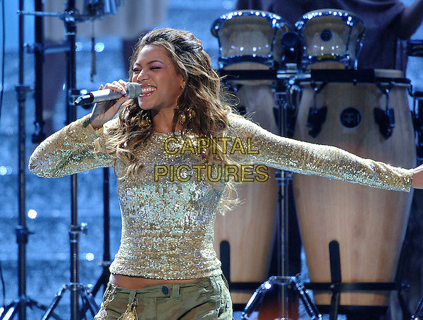 BEYONCE KNOWLES.World Music Awards 2006 Earls Court, London, UK. - Show.November15th, 2006.stage concert live gig performance music singing shiny silver gold top half length.CAP/BEL.©Tom Belcher/Capital Pictures.
