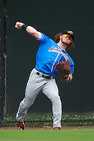 Akron RubberDucks left fielder Clint Frazier (4) throws the ball in during the first game of a doubleheader against the Bowie Baysox on June 5, 2016 at Prince George's Stadium in Bowie, Maryland.  Bowie defeated Akron 6-0.  (Mike Janes/Four Seam Images)