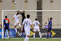 Haiti (HAI) goalkeeper Jean Dominique Zerphirin (18) punches the ball away as Brian Ching (11) attempts to head the ball. The United States and Haiti played to a 2-2 tie during a CONCACAF Gold Cup Group B group stage match at Gillette Stadium in Foxborough, MA, on July 11, 2009. .