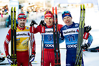 1st January 2020, Toblach, South Tyrol , Italy;  Sergey Ustiugov of Russia, Alexander Bolshunov of Russia and Iivo Niskanen of Finland celebrates after they competed in the mens 15 km classic technique pursuit during Tour de Ski on January 1, 2020 in Toblach.