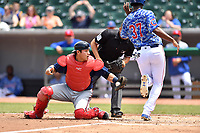 Mississippi Braves catcher Alex Jackson (25) tags out Oscar De La Cruz (37) during a game against the Tennessee Smokies at Smokies Stadium on May 20, 2018 in Kodak, Tennessee. The Braves defeated the Smokies 7-4. (Tony Farlow/Four Seam Images)