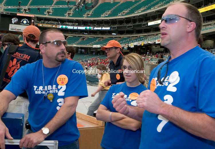 ATLANTA, GA- 29 APRIL 2006- 042906JT22-<br /> Watertown's Mike Lemay, Nikki Mickush and Sean Conway discuss their team's performance in their first match of the quarterfinals of the 2006 FIRST Robotics Championship Saturday at the Georgia Dome in Atlanta. <br /> Josalee Thrift Republican-American