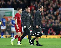 5th January 2020; Anfield, Liverpool, Merseyside, England; English FA Cup Football, Liverpool versus Everton; James Milner of Liverpool leaves the pitch with medical staff as he is substituted through injury - Strictly Editorial Use Only. No use with unauthorized audio, video, data, fixture lists, club/league logos or 'live' services. Online in-match use limited to 120 images, no video emulation. No use in betting, games or single club/league/player publications