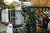 Washington, DC - October 31, 2009 -- A performer dressed as a grapevine tree stands at the gate to the North Grounds of the White House during Halloween festivities, October 31, 2009..Mandatory Credit: Pete Souza - White House via CNP