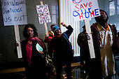 Philadelphia, Pennsylvania<br /> March 24, 2011<br /> <br /> After Philadelphia unemployed homeowners rally at City Hall demonstrators move to entrance hall of the U.S. Department of Housing and Urban Development's (HUD) regional office in the Wanamaker Building to demand immediate implementation of the EHLP program, a $1 billion program enacted by Congress to assist homeowners and to prevent foreclosure. EHLP funds, to be obligated by September 30, 2011, are to provide mortgage payment assistance of up to 24 months to homeowners who have had at least 14% drop in income due to involuntary unemployment or underemployment caused by adverse economic conditions, medical emergency or serious injury.<br /> <br /> Philadelphia Unemployment Project (PUP) organized the rally.