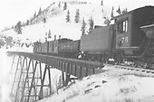 D&amp;RGW #476 with an eastbound work train crossing Cascade Creek Trestle which is painted black.<br /> D&amp;RGW  Osier, CO  ca. 1930-1939