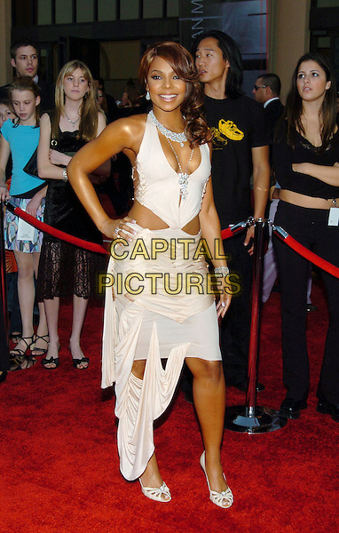ASHANTI.32nd Annual American Music Awards held at the Shrine Auditorium. .November 14th, 2004.full length, hand on hip, white cream dress, plunging neckline, weave, ribbon, cut away.www.capitalpictures.com.sales@capitalpictures.com.© Capital Pictures.