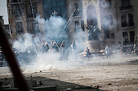 n this Tusday, Jun. 11, 2013 photo, fireworks used by protesters burst as the anti-riot police charge against them during clashes at the streets of Taksim Square in Istanbul,Turkey. (Photo/Narciso Contreras).