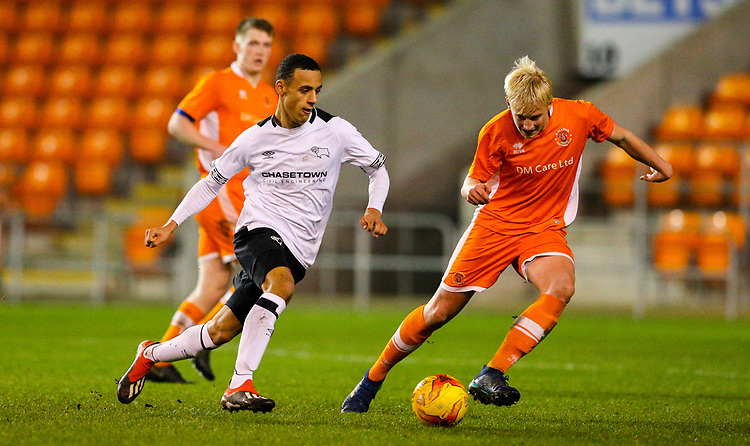 Derby County's Tyree Wilson runs at Blackpool's Harry Winstanley<br /> <br /> Photographer Alex Dodd/CameraSport<br /> <br /> The FA Youth Cup Third Round - Blackpool U18 v Derby County U18 - Tuesday 4th December 2018 - Bloomfield Road - Blackpool<br />  <br /> World Copyright © 2018 CameraSport. All rights reserved. 43 Linden Ave. Countesthorpe. Leicester. England. LE8 5PG - Tel: +44 (0) 116 277 4147 - admin@camerasport.com - www.camerasport.com