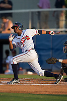Cristian Pache (15) of the Danville Braves follows through on his swing against the Pulaski Yankees at American Legion Post 325 Field on August 1, 2016 in Danville, Virginia.  The Yankees defeated the Braves 4-1.  (Brian Westerholt/Four Seam Images)