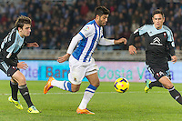 Real Sociedad's Carlos Vela (c) and Celta de Vigo's Jon Aurtenetxe (l) and David Costas during La Liga match.November 23,2013. (ALTERPHOTOS/Mikel)