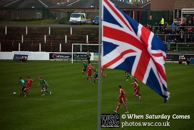 Glentoran 2 Cliftonville 1, 22/10/2016. The Oval, NIFL Premiership. A Union flag dominated the view at The Oval, Belfast as Glentoran (in green) host city-rivals Cliftonville in an NIFL Premiership match. Glentoran, formed in 1892, have been based at The Oval since their formation and are historically one of Northern Ireland's 'big two' football clubs. They had an unprecendentally bad start to the 2016-17 league campaign, but came from behind to win this fixture 2-1, watched by a crowd of 1872. Photo by Colin McPherson.