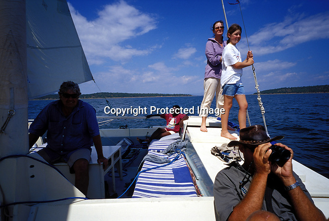 dicozim00272.African Country. Zimbabwe. Unidentified tourists on a catamaran on April 16, 2003 on Lake Kariba, a lake in Zimbabwe. The country, a popular tourist destination has lost out becuase of the deteriorating economic situation in the country. Leisure, holiday, lifestyle. .©Per-Anders Pettersson/iAfrika Photos