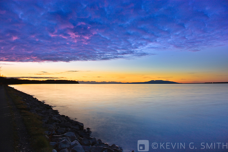 Photo of Knik arm and Mount Susitna, (Sleeping Lady) after sunset, high tide, taken from the Tony Knowles Coastal Trail, fall, Southcentral Alaska, USA.