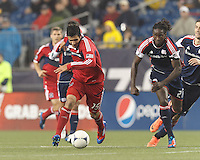 Chicago Fire midfielder Orr Barouch (15) brings the ball forward as New England Revolution midfielder Shalrie Joseph (21) closes. In a Major League Soccer (MLS) match, the New England Revolution defeated Chicago Fire, 2-0, at Gillette Stadium on June 2, 2012.