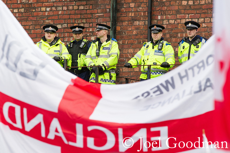 © Joel Goodman - 07973 332324 . 25/02/2012 . Hyde , UK . Many police in Hyde as the EDL demonstrate following an assault on Daniel Stringer-Prince, whose family say they do not want the demonstration to take place in the town in their son's name. The EDL say Daniel was assaulted by a gang of Asian men . At the same time , the BNP hold a rally in the town . Photo credit : Joel Goodman