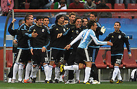 Gabriel Heinze of Argentina celebrates his goal with the team bench