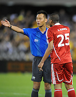 MELBOURNE, AUSTRALIA - OCTOBER 14: Khalifa Naufli from Oman argues with match referee Toma Maasaki in a AFC Asian Cup 2011 match between Australia and Oman at Etihad Stadium on October 14, 2009 in Melbourne, Australia. Photo Sydney Low www.syd-low.com