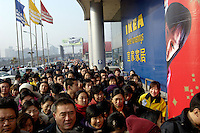 Chinese people line up to enter an IKEA store to buy discount merchandise for its 7 anniversary promotion in Beijing, China. IKEA, which started operation in China in 1998, now has three stores in Beijing, Shanghai and Guangzhou. .14 Jan 2006