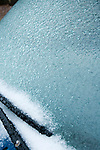 Freezing sleet on auto windshield,<br />