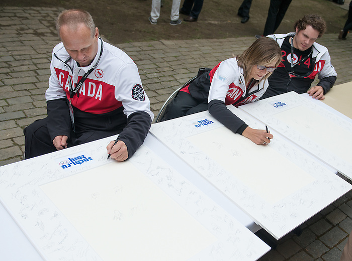 Ottawa ON - June 4 2014 - Dennis Thiesen, Sonya Godet and Brad Bowden sign autographs during the Celebration of Excellence's visit to Parliament Hill. (Photo: Matthew Murnaghan/Canadian Paralympic Committee)