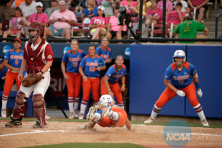 02 JUNE 2014:  Kirsti Merritt (24) of the University of Florida scores against the University of Alabama during the Division I Women's Softball Championship held at ASA Hall of Fame Stadium in Oklahoma City, OK.  Shane Bevel/NCAA Photos