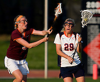 Marye Kellermann (29) of Virginia looks to shoot past Christina Patten (3) of Virginia Tech during the first round of the ACC Women's Lacrosse Championship in College Park, MD.  Virginia defeated Virginia Tech, 18-6.