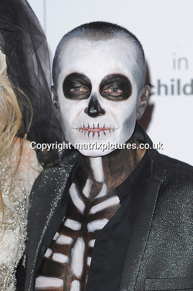 NON EXCLUSIVE PICTURE: PAUL TREADWAY / MATRIXPICTURES.CO.UK<br /> PLEASE CREDIT ALL USES<br /> <br /> WORLD RIGHTS<br /> <br /> Welsh fashion designer Julien Macdonald OBE attending the UNICEF Halloween Ball at London's One Mayfair.<br /> <br /> OCTOBER 31st 2013<br /> <br /> REF: PTY 137081
