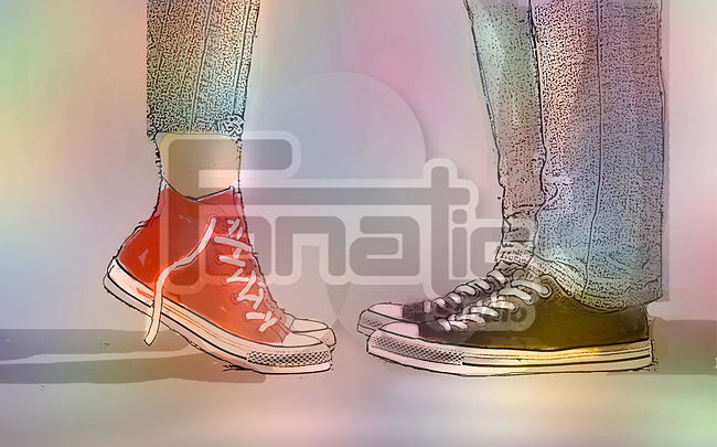 Image of the legs and feet of a boy and girl teenager. the girl is on tip toe implying a kiss