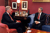 United States President Bill Clinton meets Foreign Minister Farouk al-Sharaa of Syria in the President's study in the White House in Washington, DC on October 7, 1993.<br /> Credit:  White House via CNP