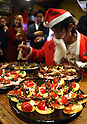 December 24, 2016, Tokyo, Japan - A man in Santa costume makes canapes with locusts at a Christmas party to eat insect foods in Tokyo on Saturday, December 24, 2016. Some 30 people gathered to eat insect foods on the Christmas Eve as UN FAO reported that eating insects could help boost nutrition and reduce pollution.  (Photo by Yoshio Tsunoda/AFLO) LWX -ytd-