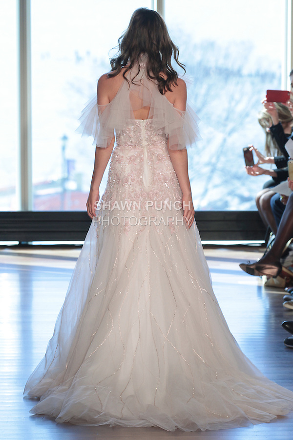 """Model Katya walks runway in a """"Ginger"""" bridal gown from the Rivini Spring Summer 2017 bridal collection by Rita Vinieris at The Standard Highline Room, during New York Bridal Fashion Week on April 15, 2016."""