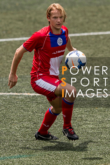 Tem Hansen of Yau Yee League Select during the match HKFC-U21 vs Yau Yee League Select during the Day 2 of the HKFC Citibank Soccer Sevens 2014 on May 24, 2014 at the Hong Kong Football Club in Hong Kong, China. Photo by Victor Fraile / Power Sport Images
