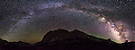 A panoramic arch of the Miky Way Galaxy arcs above a mountain peak in the High Sierra just below Pine Creek Pass on a moonless night, July 1, 2016. (Photo by Scott Sady)